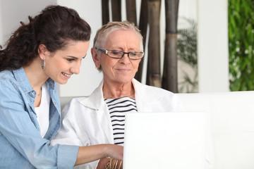 Women sitting at a laptop