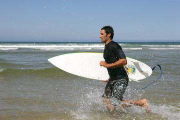 surfer in profile running