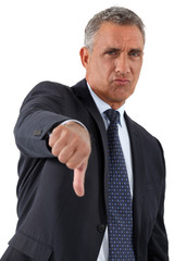 Disapproving businessman giving the thumb's down