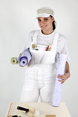 Female decorator holding wallpaper