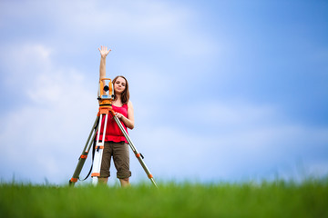 Young female land surveyor at work