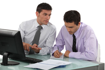 Two businessmen working on project