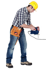 craftsman working with an electric cutter