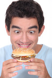 Man holding cheeseburger