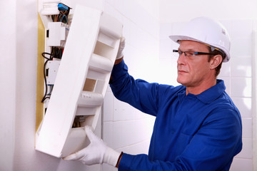 Electrician with a fusebox
