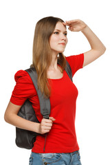 Female teenager with backpack looking forward