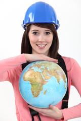 female apprentice holding globe