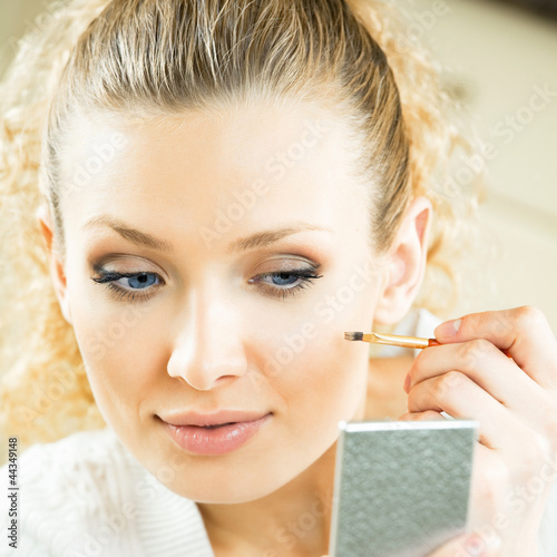 Makeup Mirrors on Cheerful Woman With Mirror And Makeup Brush By Vgstudio  Royalty Free
