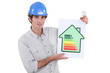 Constructor holding energy rating sign