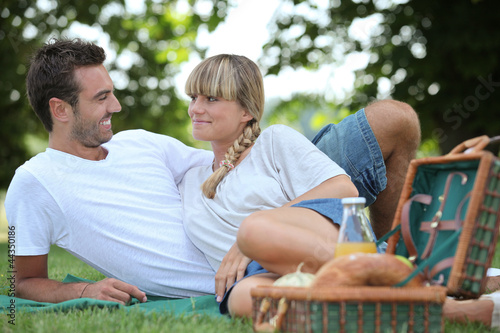Young couple having a picnic in the park