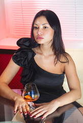 woman with glass of peach-brandy