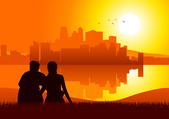 Silhouette of a couples watching cityscape during sunset