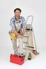 Carpenter with equipment, studio shot