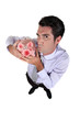 Businessman holding piggy-bank