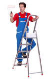 Painter painting whilst up ladder