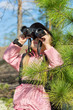 Child with binoculars looking up