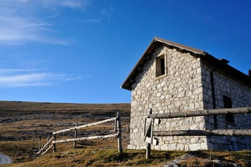 mountain hut with grass and blue sky