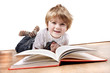 young 4 year old boy reading a book