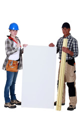 female carpenter posing with senior instructor