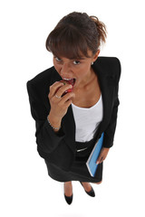 Woman biting apple