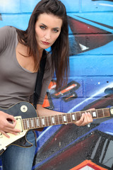 Urban woman with a guitar