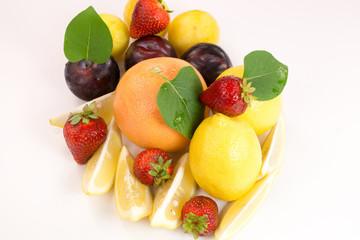 Lemon, orange and plums