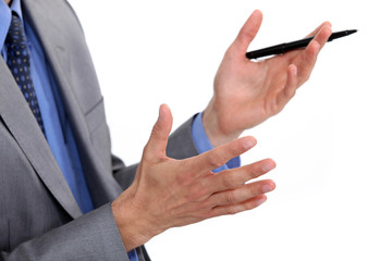 A cropped picture of a businessman holding a pen.