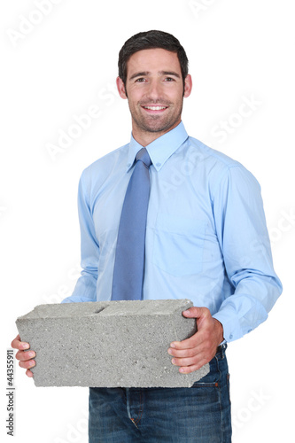 Engineer carrying a stone