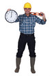 Construction worker holding clock