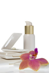 collection of make up products with an orchid head