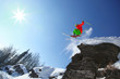Skier jumping from the cliff in high mountains