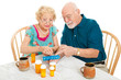 Senior Couple Sorts Medications