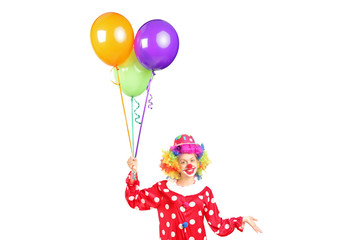 Female clown, happy joyful expression on face, with a bunch of b