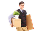 A person with moving box and other stuff