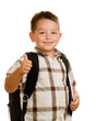 Happy schoolboy wearing backpack and giving thumbs up