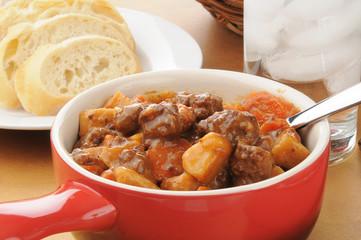 Beef stew in a serving crock