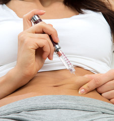 woman patient make an abdomen subcutaneous syringe injection