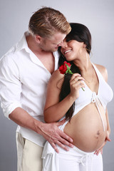 Couple enjoying pregnancy