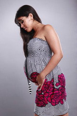 Cute pregnant young woman