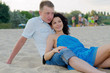 Young couple relaxing on a beach