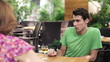 Relationship difficulties, couple arguing in cafe