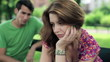 Relationship difficulties, couple sitting in park