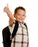Fototapety Happy schoolboy wearing backpack and giving thumbs up