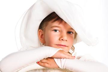 sweet little girl wearing an old style light hat