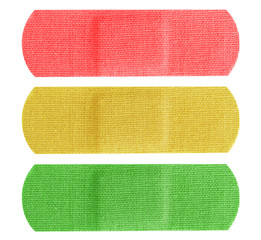 Red yellow and green bandaids