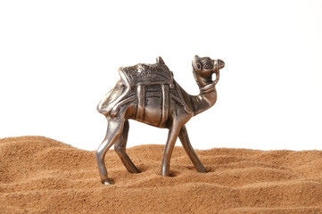 Souvenir figurine of a camel made of metal, isolation