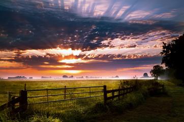 colorful sunrise in rural Groningen