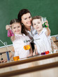 Little pupils learn chemistry with their teacher