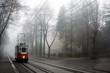 Leinwandbild Motiv Historic tram in the fog