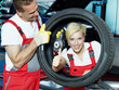 Female apprentice for mechanic is happy, shows thumb up